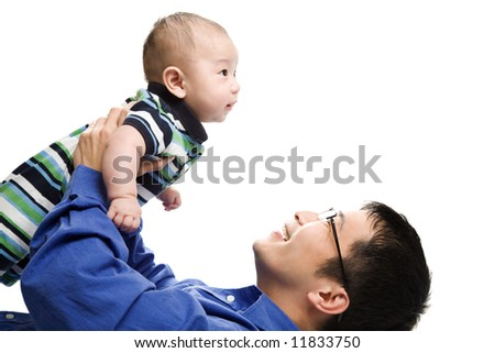 An isolated shot of an asian father playing with his son - stock photo