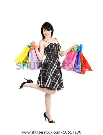 An isolated shot of beautiful woman carrying shopping bags - stock photo
