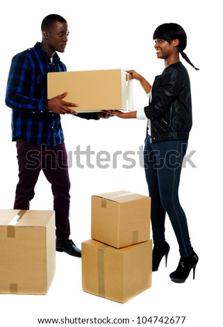 An isolated shot of couple moving empty cartons to new place - stock photo