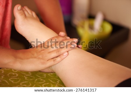 An obese girls feet getting massaged by her local beautician, at her spa day out - stock photo