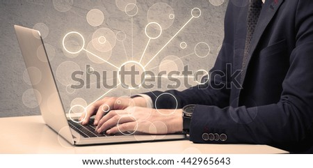 An office salesman in elegant suit working on a scientific project with the help of a laptop concept - stock photo