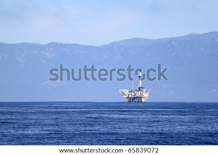 an offshore oil drilling platform near Ventura California - stock photo