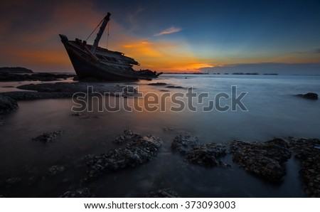 An old abandoned fishing boat stand on a beech. - stock photo