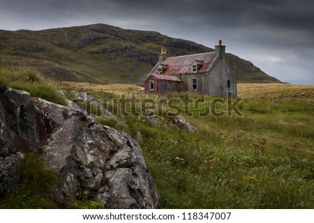 An Old Abandonned cottage on a hillside in Eriskay in the Outer Hebrides - stock photo