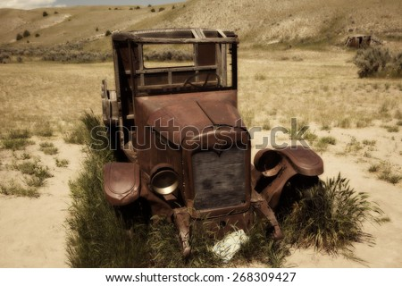 An old and abandoned vintage car at the Bannack Ghost Town - stock photo
