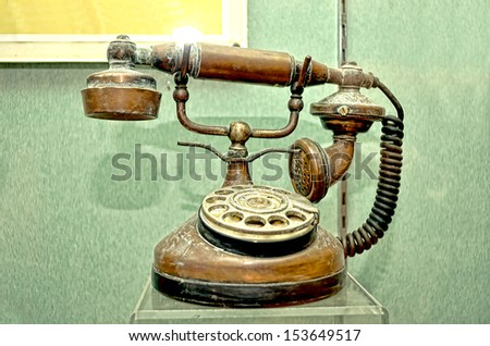 An old and classic telephone - stock photo