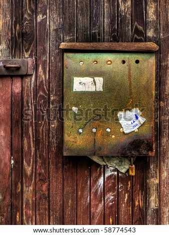 an old and rusty letter box - stock photo