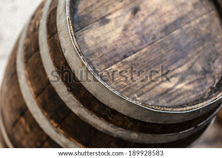 an old and weathered wooden barrel in a medieval fair - stock photo