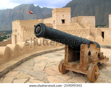An old Arab cast-iron cannon in Al Hazm Fort in Oman.It's an outstanding example of Omani Islamic architecture and was built in 1711 AD. - stock photo