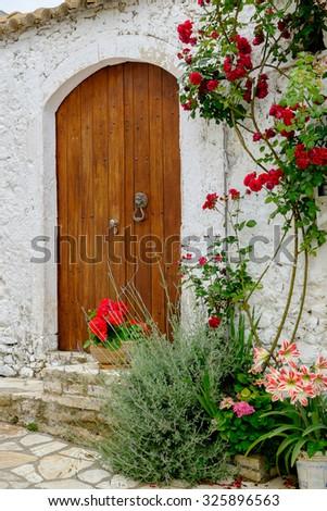 An old beautiful door in Afionas village, Corfu, Greece. - stock photo