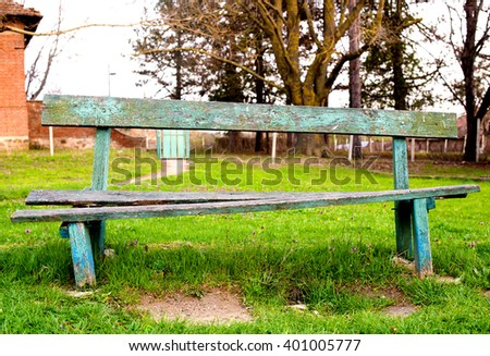 an old bench in the village Park - stock photo