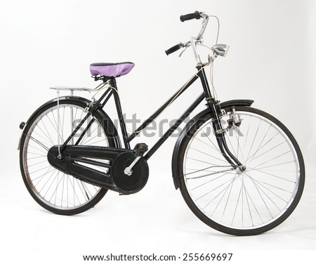An old bicycle full of retro style - stock photo