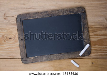 An old blank blackboard and white chalk - stock photo