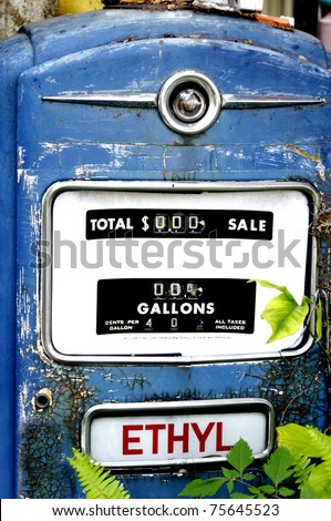 An old blue antique pump that shows gas as being forty cents a gallon. - stock photo