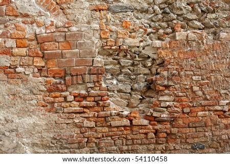An old brick wall in an Italian village - stock photo
