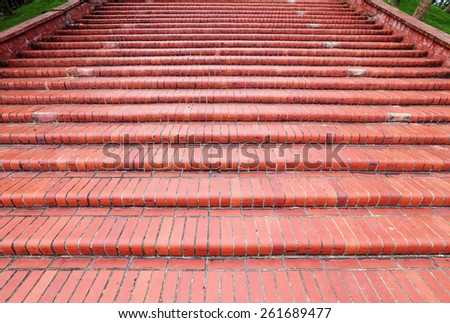 An old brown brickwork stairway.  - stock photo