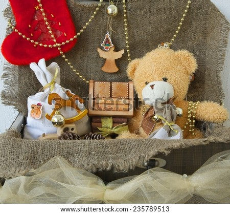 An old case with decorative items and presents for a festive season - stock photo