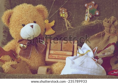 An old case with decorative items and presents for a festive season. Vintage photo - stock photo
