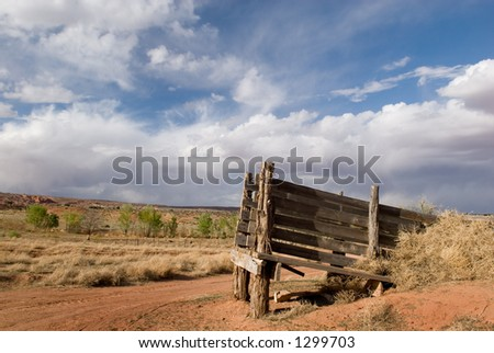 An old cattle chute stands against an amazing blue sky in America's beautiful desert near Escalante, Utah - stock photo