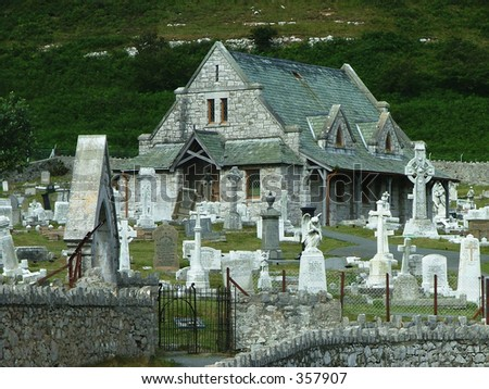 An old chapel and graveyard - stock photo