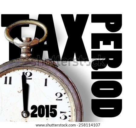 An old clock counting down with imprint of year 2015 Tax period, for the concept of tax submission timeline. - stock photo