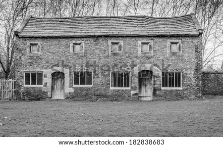 An old dilapidated brick barn in England - stock photo