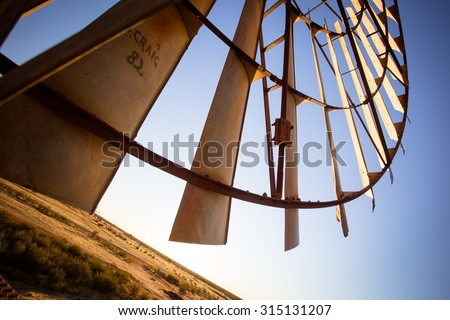 An old disused windmill at dawn near Gemtree, Northern Territory, Australia - stock photo