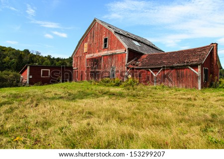 An old falling down barn in rural back-country Vermont. - stock photo
