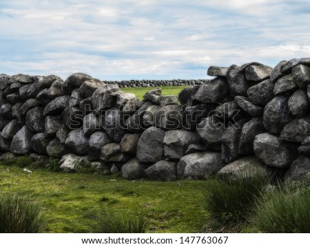 an old farm wall in the mournes ireland - stock photo