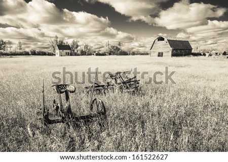 An old farm yard on the Canadian Prairies. Taken with an infrared monochrome sepia filter. - stock photo
