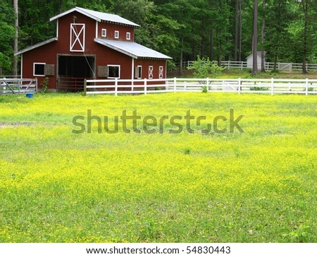 An old farmers horse bar in the field with room for your text - stock photo