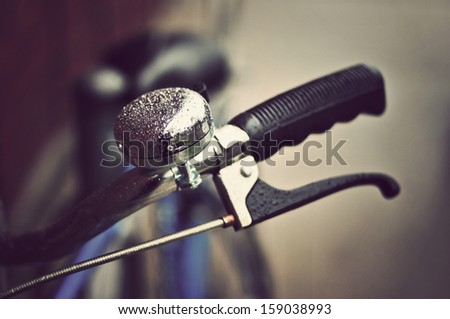 An old-fashioned blue vintage bike handlebars - with droplets - stock photo