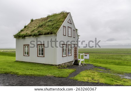 An old fashioned Icelandic house with a turf roof - stock photo