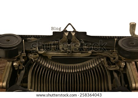 An old fashioned typewriter the word Blog. Closeup of the antique machines ribbon and carriage. - stock photo