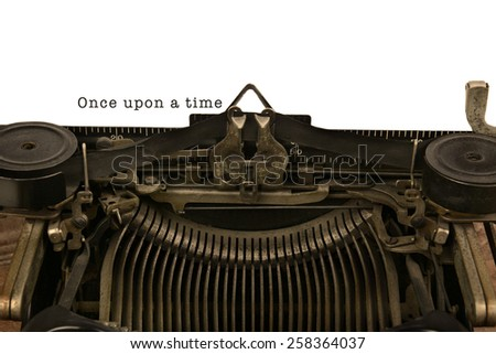 An old fashioned typewriter with the words Once upon a time. Closeup of the antique machines ribbon and carriage. - stock photo