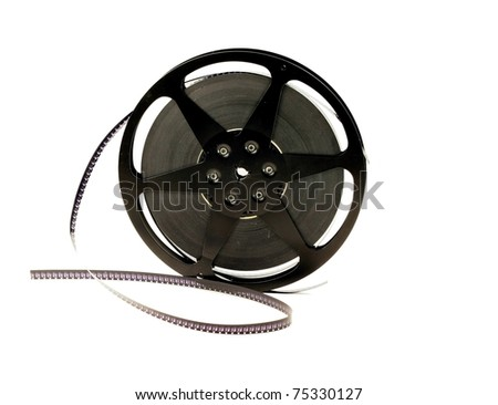 An old film reel with film on a white background - stock photo