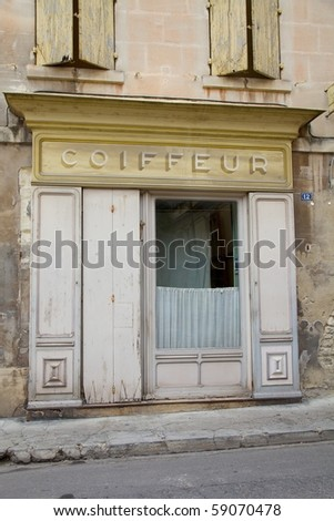 An old French Coiffeur shop - stock photo