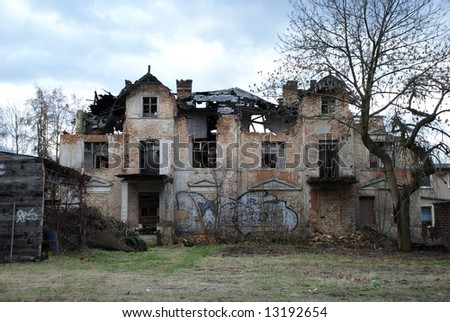 An old ghostlike house in Berlin, destroyed by a storm and uninhabited since many years. - stock photo