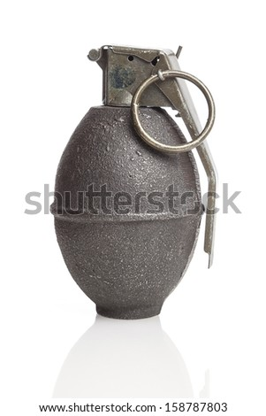An old green hand grenade on a white background. - stock photo