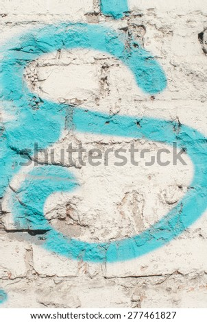 An Old Grunge White Brick Wall with Paintings - stock photo