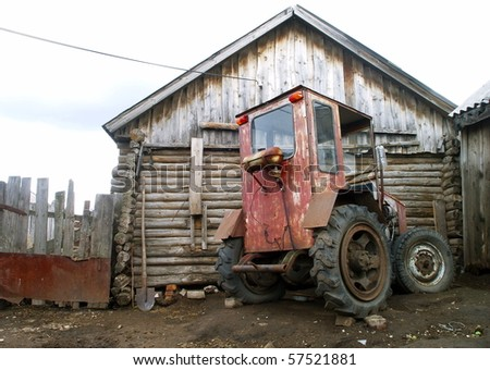 An old homemade agricultural wheel tractor - stock photo
