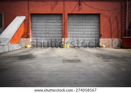 an old industrial building metal garage door - stock photo