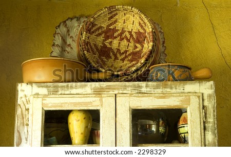 An old  kitchen cabinet and yellow wall. - stock photo