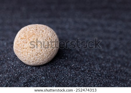 An old  limestone rock in a relaxing zen garden - stock photo