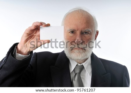 an old man keeps a white card visit - stock photo