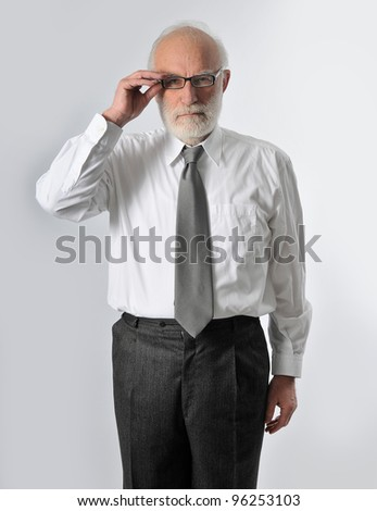 an old man wearing his glasses - stock photo