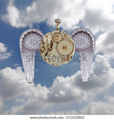 An old mechanical watch with purple color wings against a blue cloudy sky for the concept of time flies. - stock photo