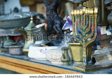 An old Menorah and other Judaica and artifacts in an antique store in Jaffa, Tel Aviv, Israel - stock photo