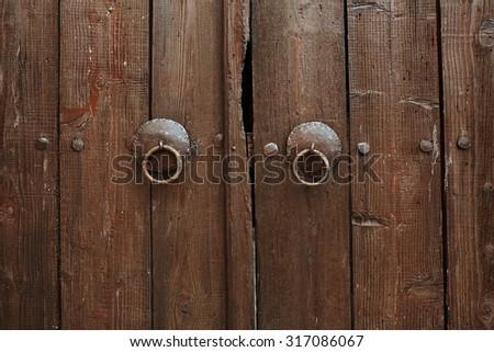 an old metal door handle knocker - stock photo