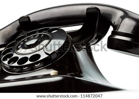 an old, old landline telephone. phone on white background. - stock photo